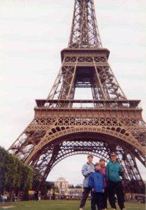 My brothers, mother, and I in front of the Eiffel Tower in 1998.